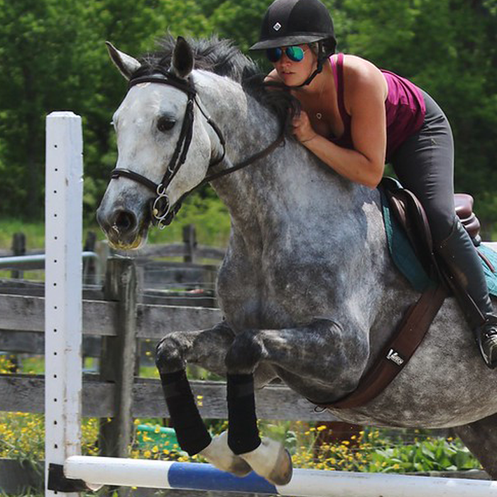Draper polos on jumping horse