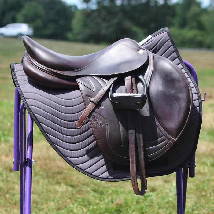 Charcoal All Purpose Pad on saddle rack.