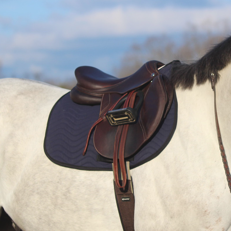 Jumper saddle pad on horse