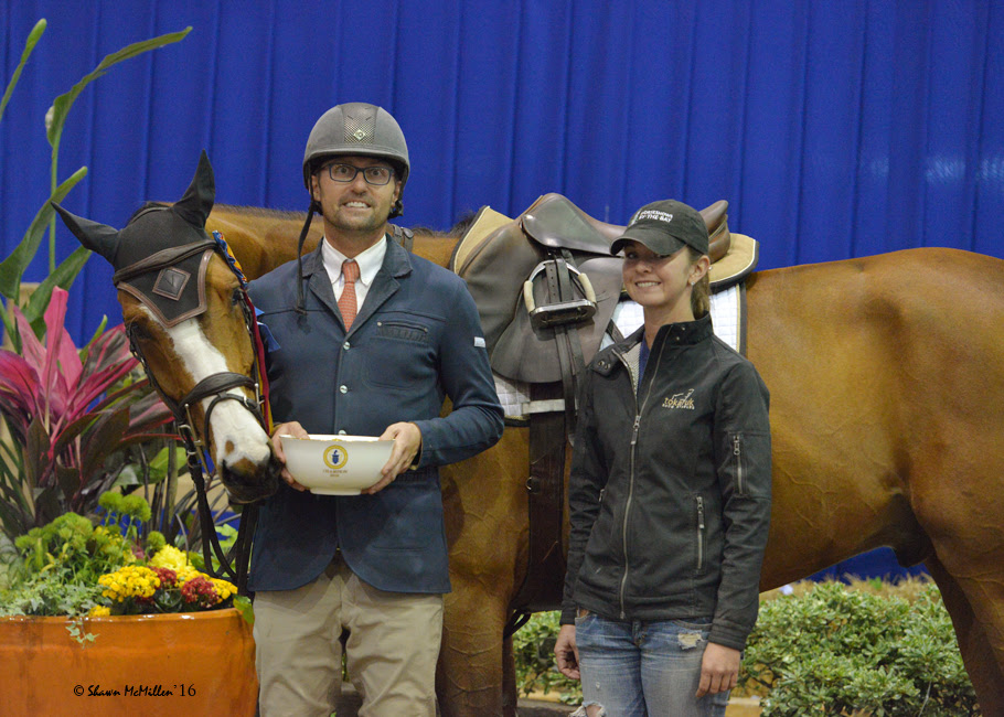 Michael Tokaruk and barn manager Cameron Callaghan accept the award for Alex Turner's Vanrock, who won the 1.25m Championship. Photo Shawn McMillen