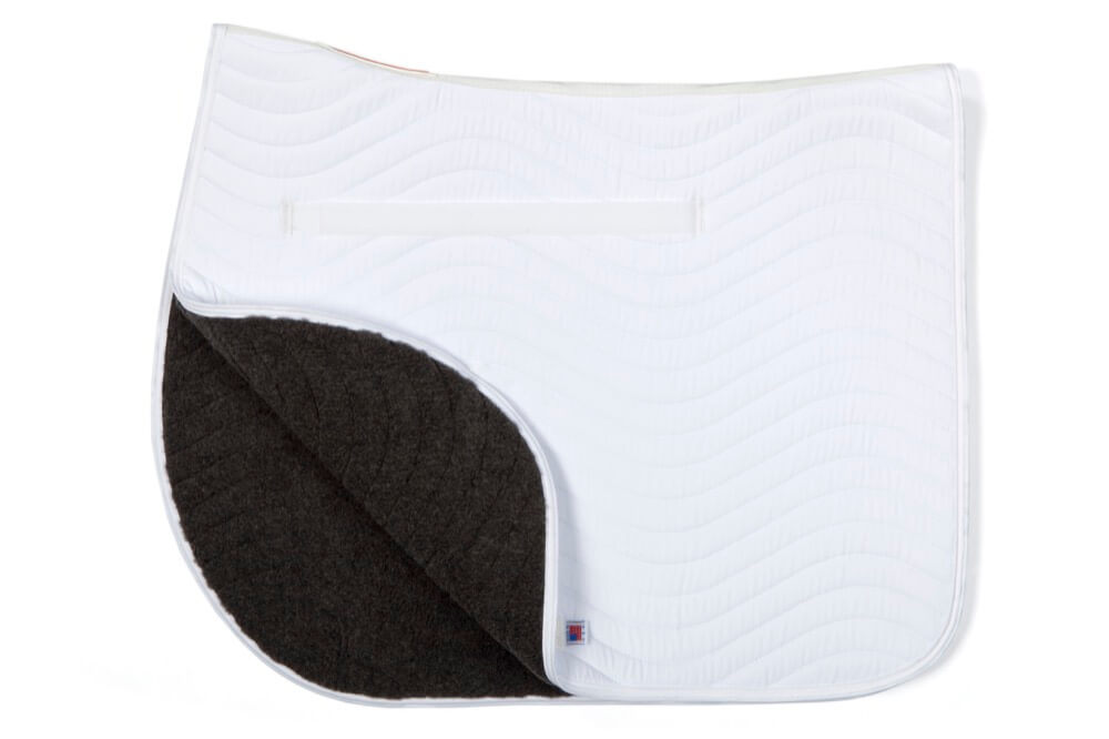 Draper Equine Therapy® Dressage Saddle Pads are made to increase blood flow and regulate body temperature in your horses back during exercise.